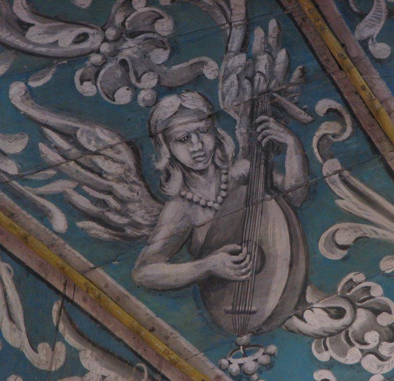 Schilderwerk onder het orgel - luitspeelster